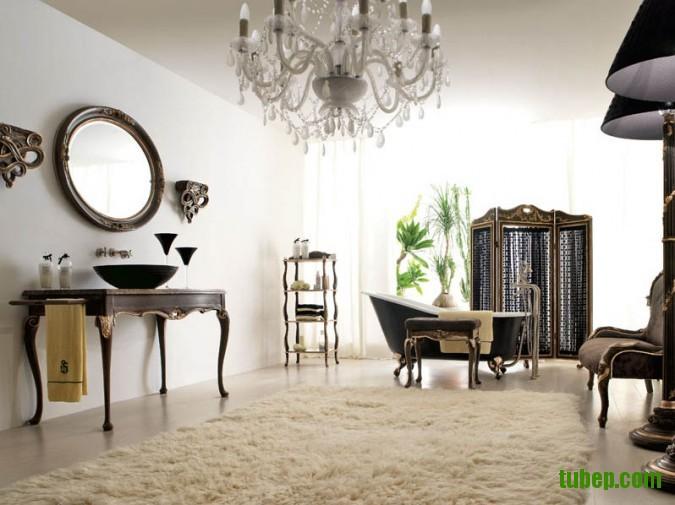 dark-wood-vanity-and-round-mirror-plus-black-bathtub-white-fur-rug-black-chairs-under-white-chandelier-in-bathroom-design-675x505