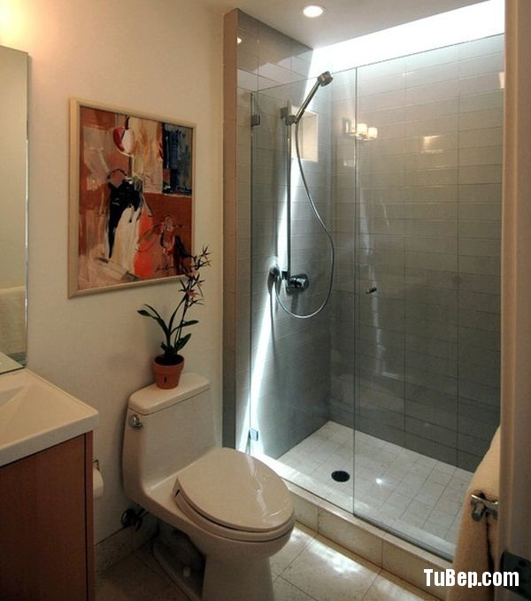 Sliding-glass-door-shower-enclosure-in-an-Asian-styled-bathr-0f630