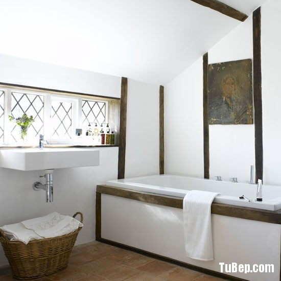 Oak beam timber framed room terracotta stone floor tiles square rectangular Philippe Starck wash basin sink modern bath real home L etc 06/2008 pub orig