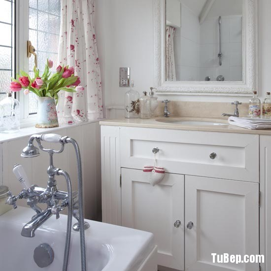 All white bathroom, washbasin sink and washstand cupboard, mirror, bath mixer tap real home 25 BH 06/2010 pub orig