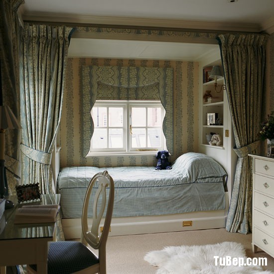 Classic-blue-and-cream-childs-bedroom-with-floor-to-ceiling-