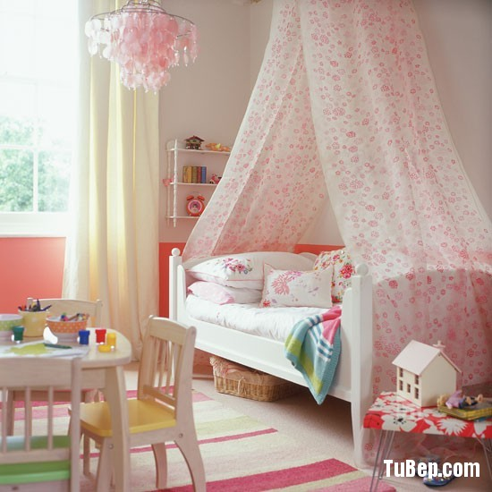 Classic-cream-and-pink-childs-bedroom-with-floral-bed-canopy