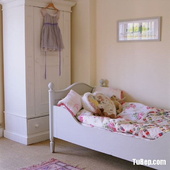 Classic-pale-painted-childs-bedroom-with-French-furniture-Ho