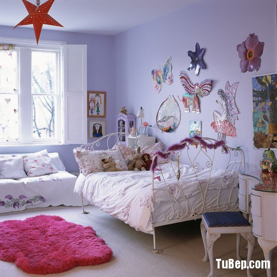 Classic-pale-painted-childs-bedroom-with-decorative-artwork-