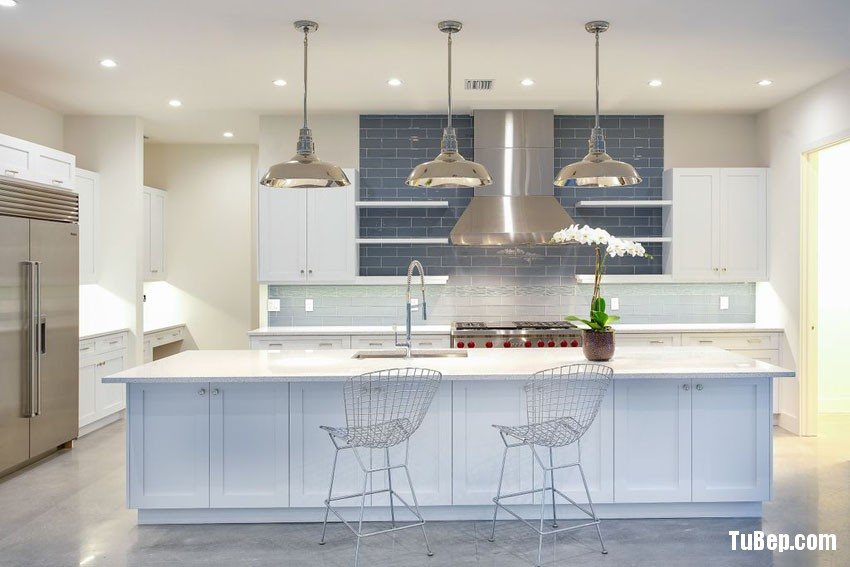 modern-beach-style-kitchen-with-polished-concrete-floors-white-cabinets-and-blue-subway-tile-backsplash