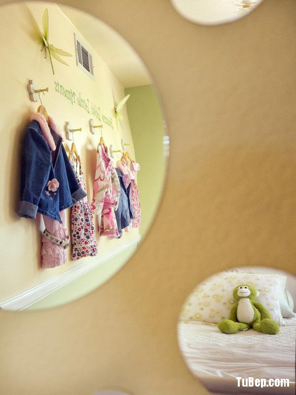 The whimsical round mirrors help open up the rather small room.