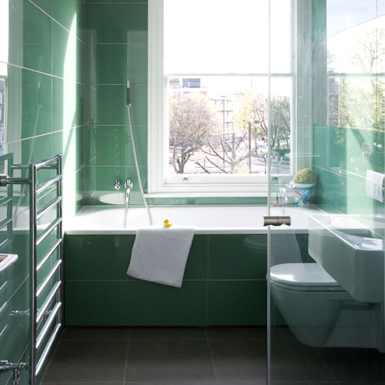 Green bathroom floor to ceiling tiled walls and bath surround real home L etc 02/2009 pub orig