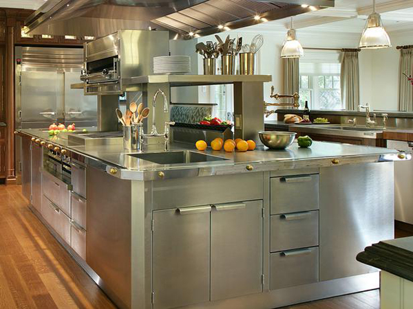 A stainless steel island in the middle of the kitchen with stainless steel cabinets desined by Peter Salerno.